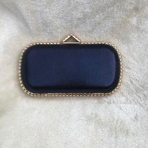 NWOT Metallic Blue Clutch With Gold Accents